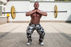 Man Doing Front Squats Stock Image