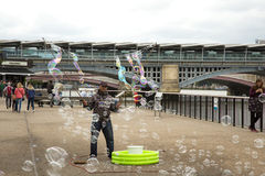 Man doing giant soap bubbles Royalty Free Stock Photography