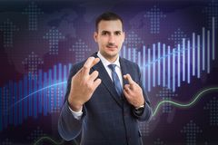 Man doing good luck gesture with fingers royalty free stock images