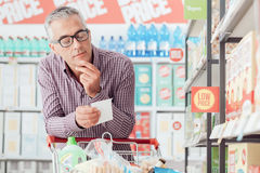 Man doing grocery shopping royalty free stock images