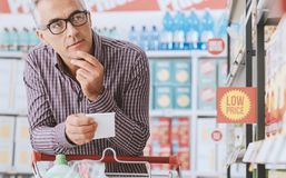 Man doing grocery shopping stock photos