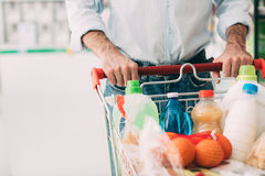 Man doing grocery shopping Stock Images