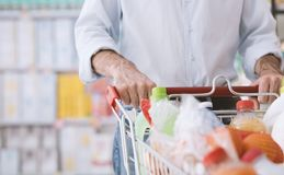 Man doing grocery shopping royalty free stock photos