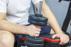 Man doing hammer exercise with dumbbell Stock Image