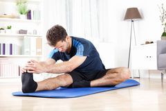 Man Doing Hamstring Stretch on Top of a Mat Royalty Free Stock Photo