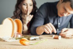 Man doing handmade gift for his beloved wife or girlfriend Stock Photos