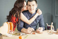 Man doing handmade gift for his beloved wife or girlfriend Royalty Free Stock Photos