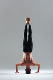Man doing headstand Stock Image