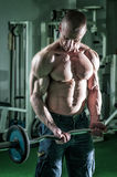 Man Doing Heavy Barbell Exercise Stock Photo