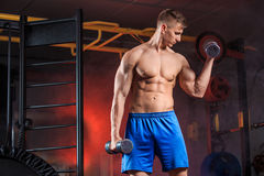 Man doing heavy weight exercise with dumbbells in gym Stock Photos