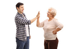 Man doing a high five with his grandma Stock Photography