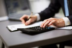 Man doing his accounting. Financial adviser working Stock Photos