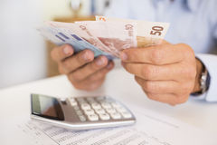 Man doing his accounting, financial adviser working royalty free stock image