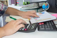 Man doing his accounting, financial adviser working stock image