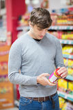 Man doing his groceries. In the supermarket Royalty Free Stock Photo
