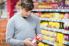 Man doing his groceries. In the supermarket Royalty Free Stock Images