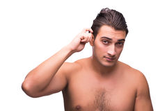 The man doing his hair isolated on white Royalty Free Stock Photo