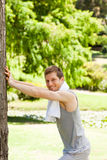 Man doing his stretches in the park Royalty Free Stock Images