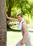 Man doing his stretches in the park Royalty Free Stock Photo
