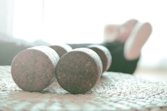 Man doing home training at floor. Dumbbells and crunches exercises. Empty copy space Stock Photography