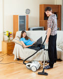 Man doing house cleaning with vaccuum cleaner Stock Photo