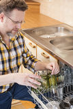 Man doing household chores Stock Photo