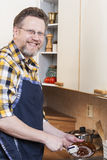 Man doing household chores Stock Photos
