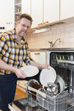 Man doing household chores Royalty Free Stock Image