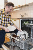 Man doing household chores Stock Photos
