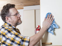 Man doing household chores Stock Images