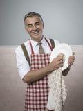 Man doing household chores Royalty Free Stock Photos