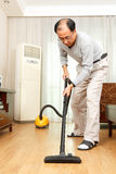 Man doing housework Royalty Free Stock Image