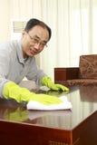 Man doing housework Stock Images