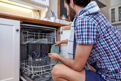 Man doing housework Stock Photo