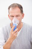 Man doing inhalation Stock Photo