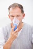 Man doing inhalation Stock Photo