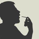 Man Doing Inhalation. Spray sore throat Stock Photo
