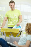 Man doing ironing Stock Photography
