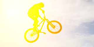 Man doing an jump with a bmx bike . Stock Photography