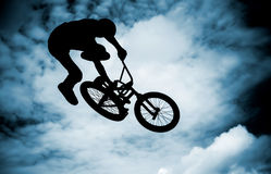 Man doing an jump with a bmx bike. Royalty Free Stock Photography
