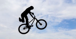 Man doing an jump with a bmx bike. Stock Photo