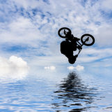 Man doing an jump with a bmx bike. Royalty Free Stock Image