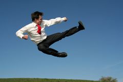 Man doing a karate kick Stock Images
