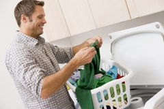 Man Doing Laundry royalty free stock image