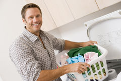 Man Doing Laundry Royalty Free Stock Images