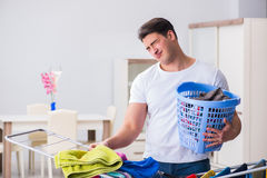 The man doing laundry at home Stock Photos