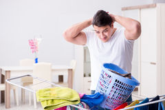 The man doing laundry at home Stock Image