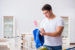 The man doing laundry at home Royalty Free Stock Photos