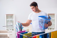 The man doing laundry at home Stock Photography
