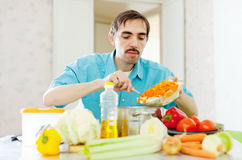 Man doing  lunch with vegetables Royalty Free Stock Image